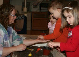 Learning science with daycare children at A Quiet Forest Daycare and Preschool in Duvall WA.