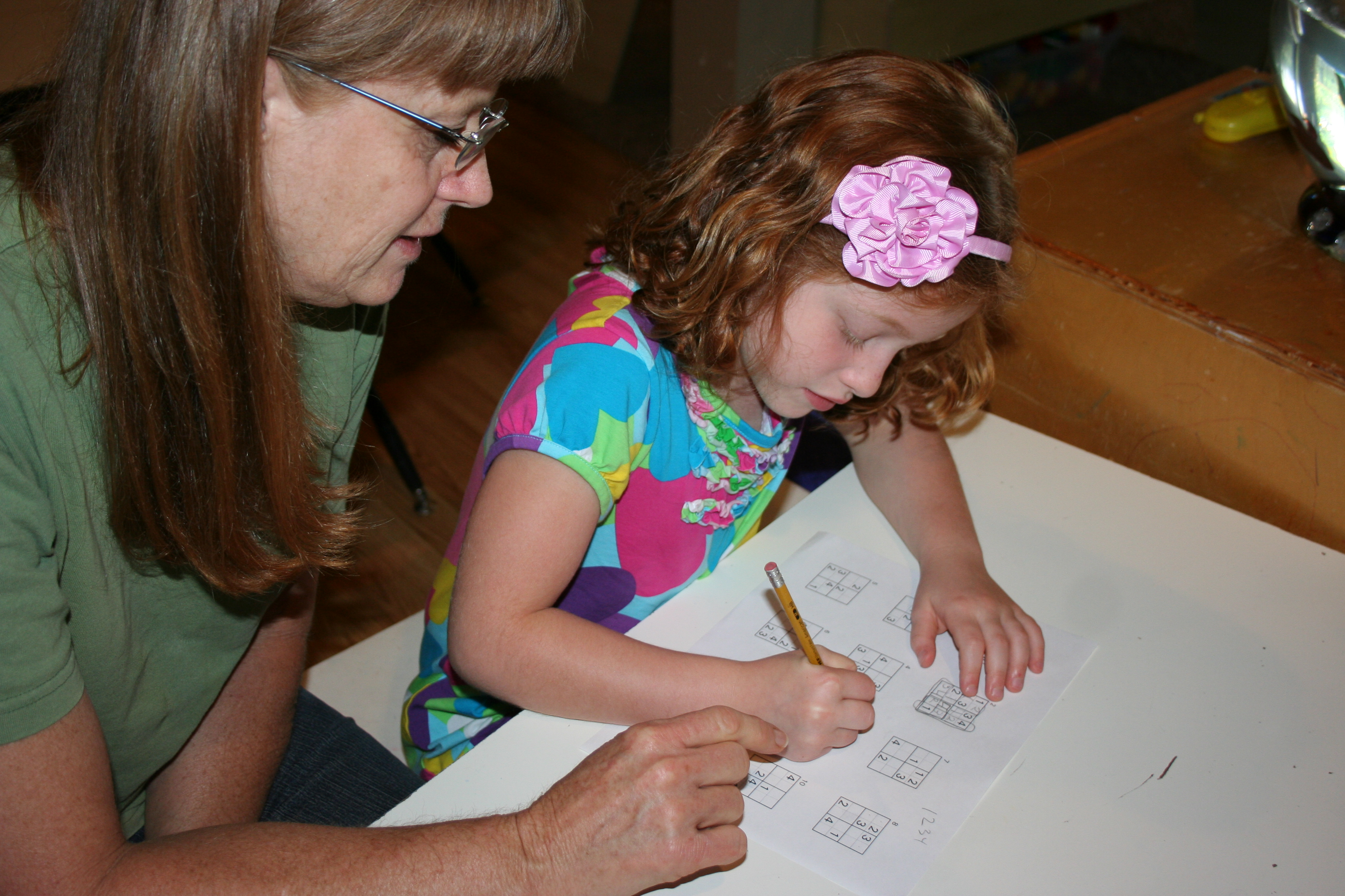 Table work with Margie with at A Quiet Forest daycare and Preschool in Duvall WA